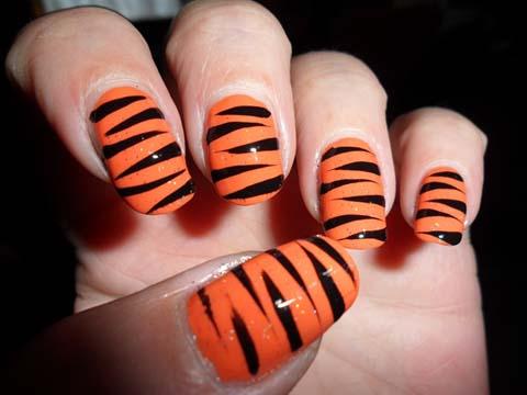 Awesome orange zebra Animal print nail art
