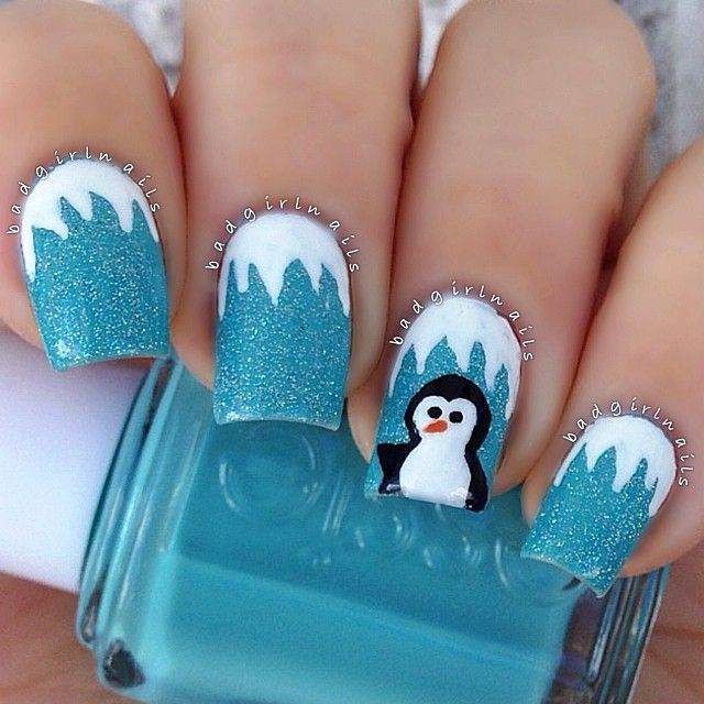 Beautiful blue snowman Christmas nail art