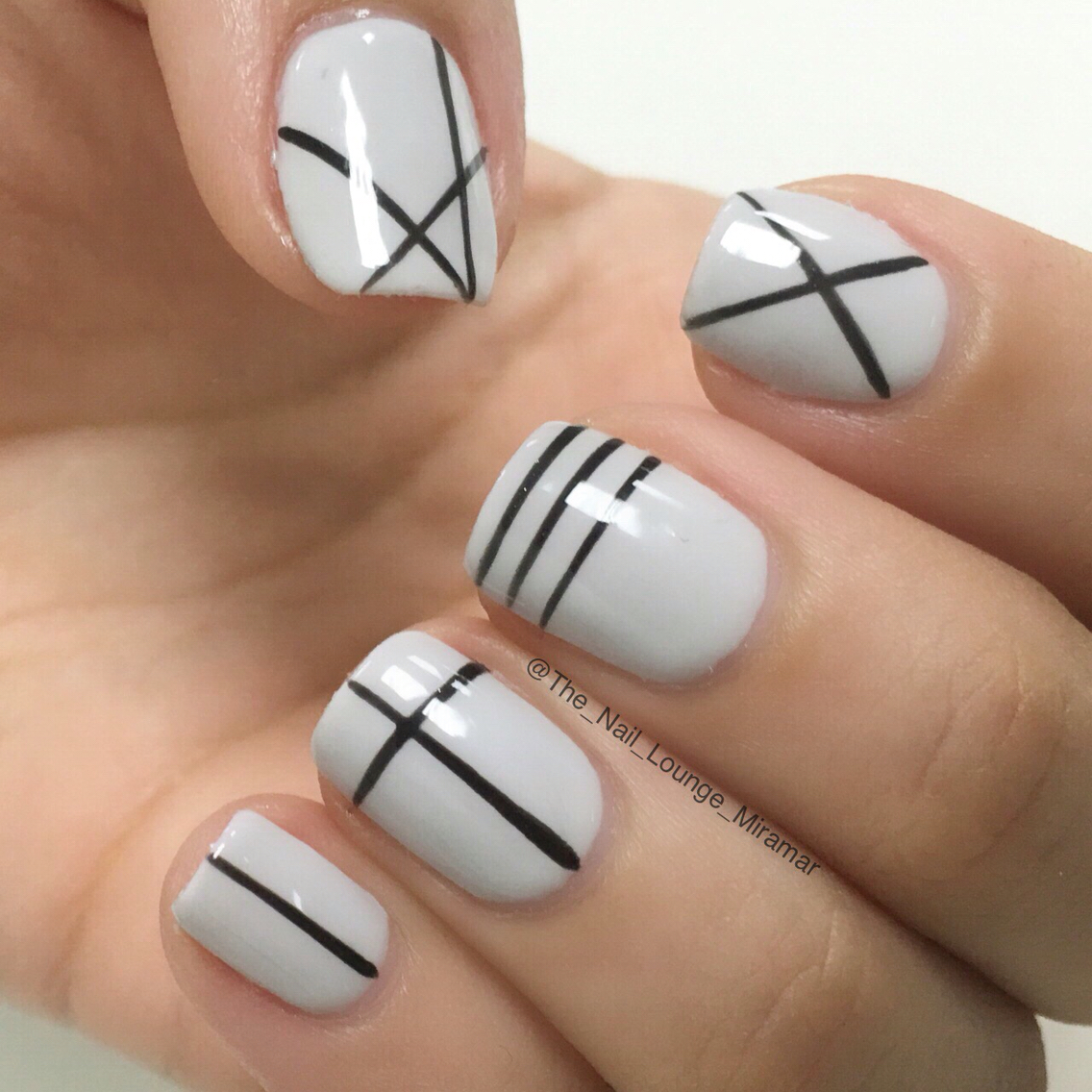 Catchy grey black design Stripe nail art