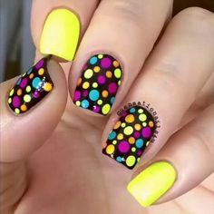 Catchy yellow Polka dots nail art
