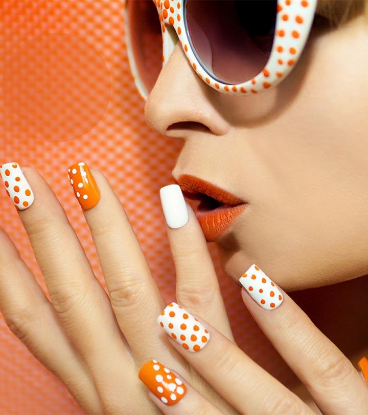 Cool orange white Polka dots nail art