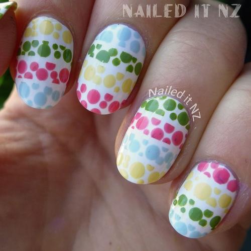 Delicate white colorful Polka dots nail art