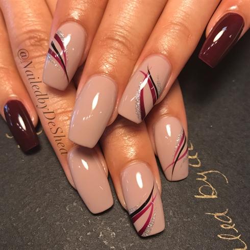 Epic chocolaty with light design print Classy nail art