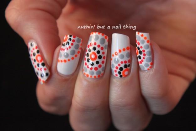 Glorious white orange Polka dots nail art