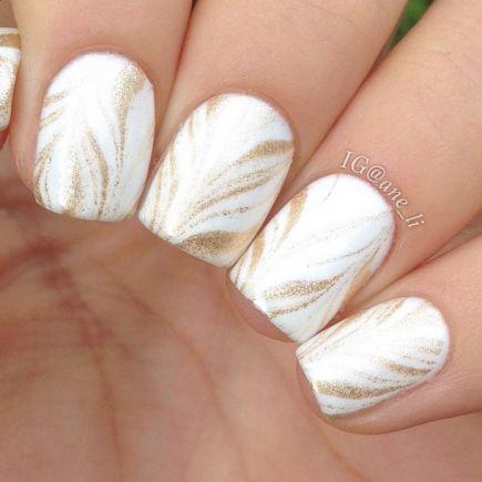Gorgeous golden white Marble nail art