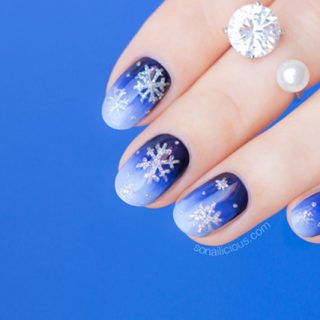 Lovely blue snowflake Christmas nail art