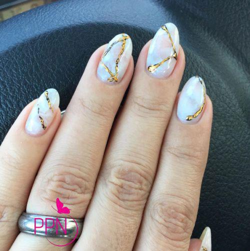 Lovely golden lines Marble nail art
