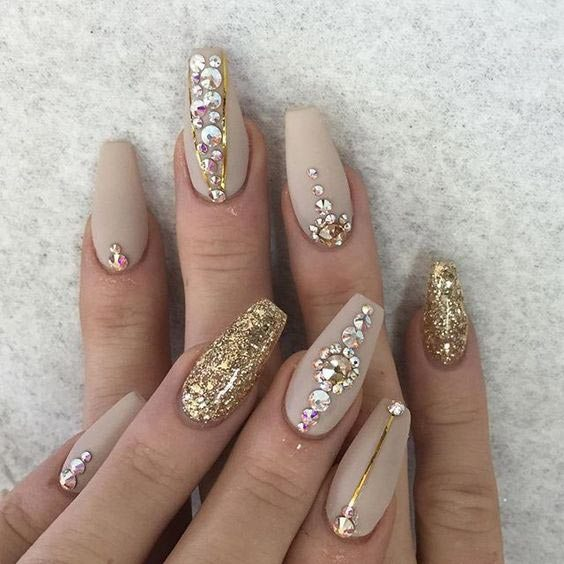Marvelous golden stones Glitter nail art