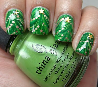 New green marbled stars Christmas nail art