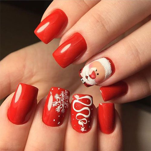 Pretty orange Santa Christmas nail art