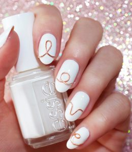 Small white golden work Marble nail art