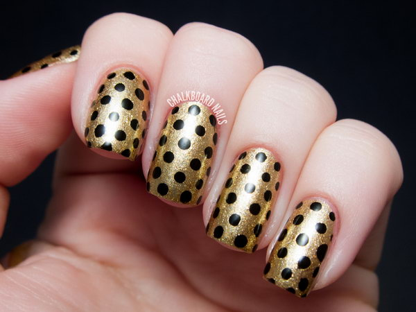 Stylish golden black Polka dots nail art