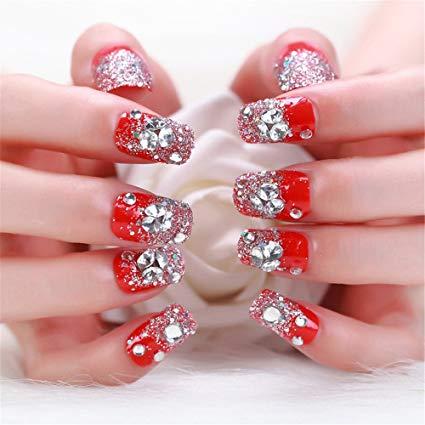 Trending orange glitter Stones nail art