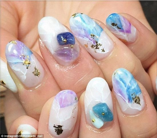 Wonderful floral white blue Stones nail art