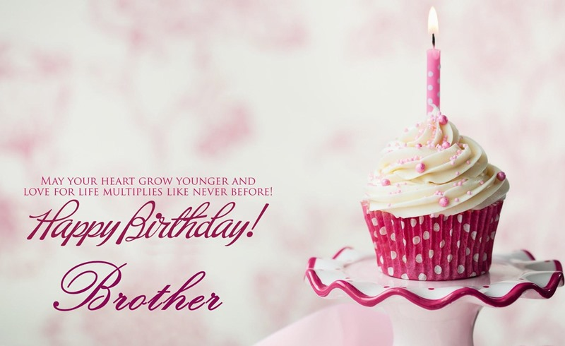 Happy birthday Brother may your heart grow younger cup cake with candle wish for him