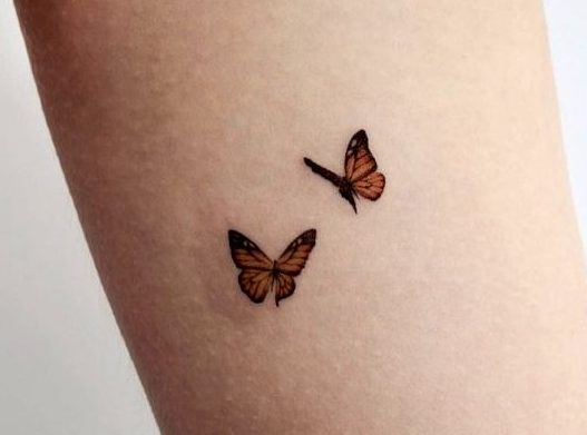 Mind Blowing Flying Butterfly Tattoo Design