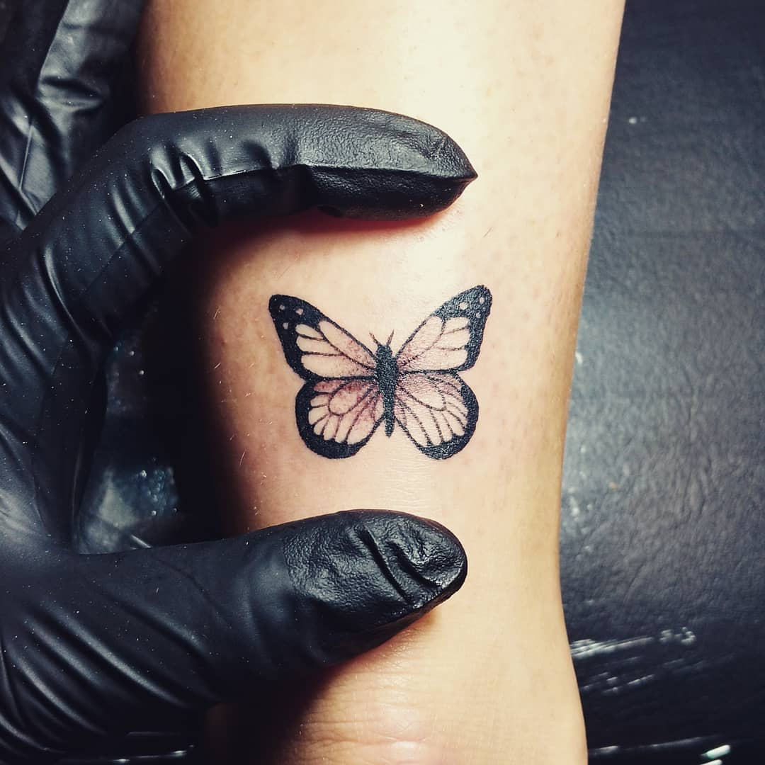 Small Butterfly Baby Tattoo On Arm