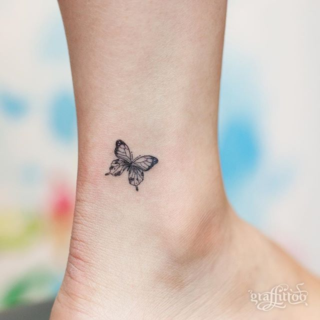 Smallest Butterfly Tattoo Made With Black Ink On Ankle