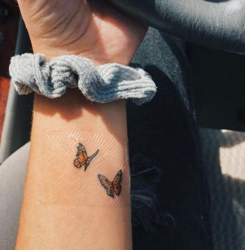 Two Small Flying Butterfly Couple Tattoo